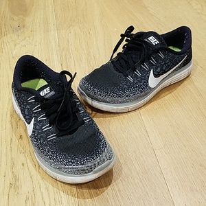 Black and White Nike Running Natural Ride Sneakers